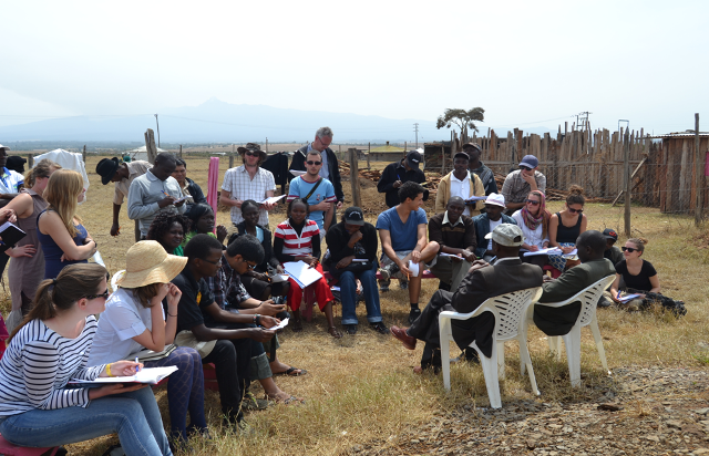 Students holding a group discussion during the field training