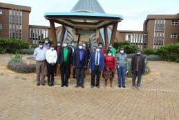 Officers from the Kenya Forestry Research Institute (KEFRI), the Kenya Forest Service (KFS) led by Dr. Joram Kagombe and WMI staff led by Prof. David Mungai, Director WMI, pose for a photograph at the Wangari Maathai Fountain of Peace after a first joint meeting to plan for the establishment of a multi-functional tree nursery at the Wangari Maathai Institute (12th February, 2021)