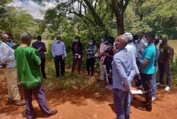 Prof. David Mungai, Director, WMI, with WMI PhD and MSc students discussing the impact of riparian zone encroachment by human settlements and agricultural activities at the CAVS dam (Field Station) on March 19, 2021